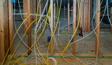 Electric cables in an apartment Interior wall framing with piping and wiring installed