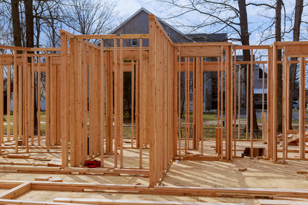 Wood Building frame at Multi-Family Housing Construction Site post and beam construction