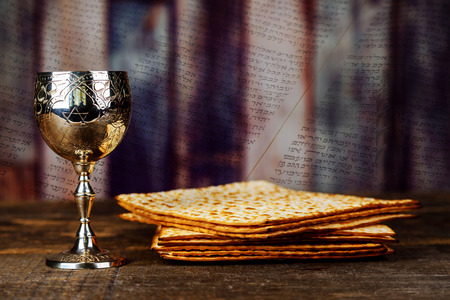Jewish Matzah bread with wine. Passover Pesah celebration concept
