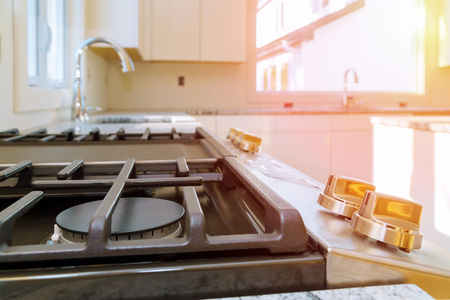 NEW gas stove close up Gas Cooker Installation Gas Appliance Repair in new house Banco de Imagens