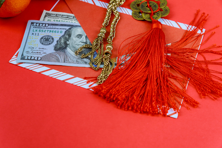 Lucky Money US dollar money Packet in red background,Happy Chinese new year concept,