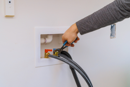 Plumber Installation Hoses for to washing machine using wrench