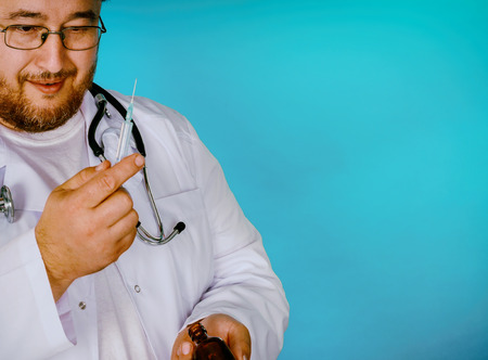 Male doctor prepares operating room to do a inoculation Stock Photo