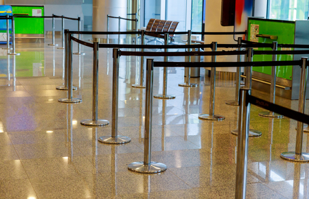 Interior with empty check-in lines on airport row of empty in airport lobby