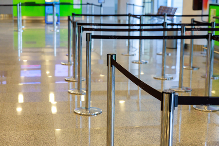Row empty check-in desks in international airport, waiting area in airport terminal
