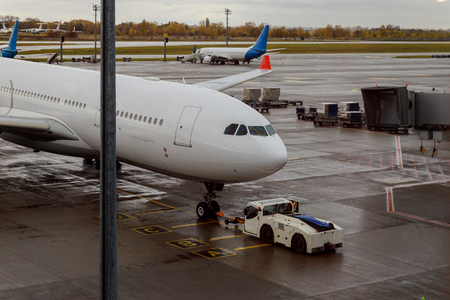 Plane on the runway with aircraft maintenance. Stock Photo