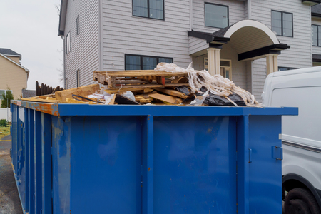 Dumpsters being full with garbage container trash on ecology and environment
