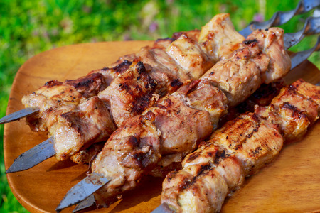 Shish kebab with the mix of spices on bbq cooking meat