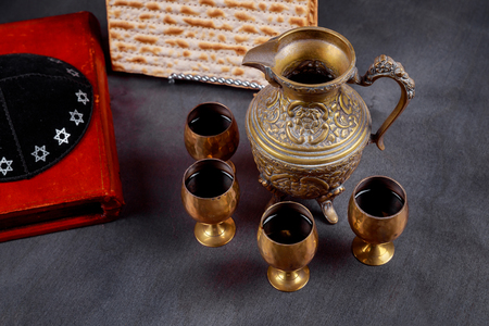 Pesach Passover symbols of great Jewish holiday. Traditional matzoh and wine in glass. Retro style 스톡 콘텐츠