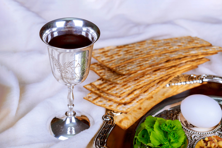 Red kosher glasses wine with a of matzah a Passover Haggadah