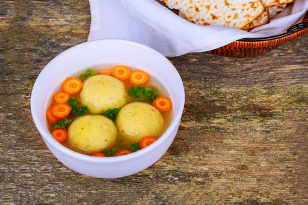 Jewish Passover hot homemade matzo ball soup in a bowl