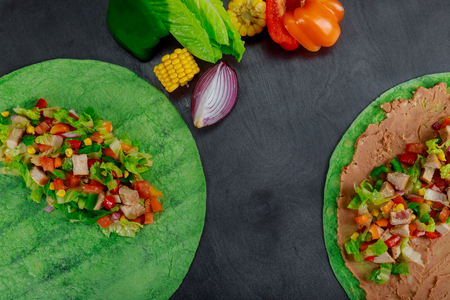 Ingredients for Mexican burito fresh vegetables in pita bread, restaurant fast food close up Stock Photo