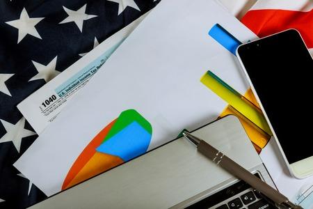 Top veiw USA IRS tax form 1040 and a U S flag selective soft focus Stock fotó