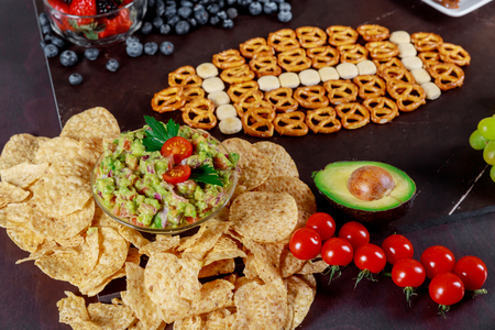 Snacks and with chips and salsa out for american super bowl watching party top view
