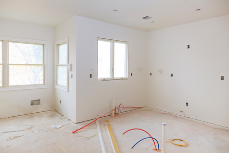 Interior construction of housing with drywall installed door for a new home before installing Imagens