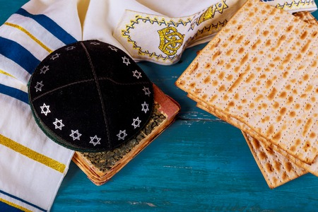 Close up of concept jewish holiday passover matzot and tallit bread on the Jewish holiday.