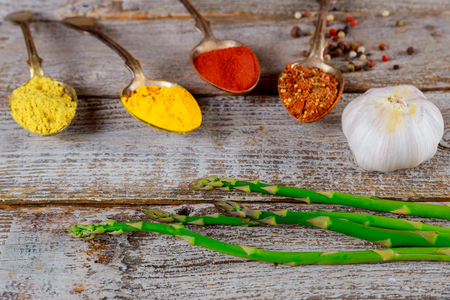Assortment colorful of spices collection and herbs, garlic and asparagus selective focus