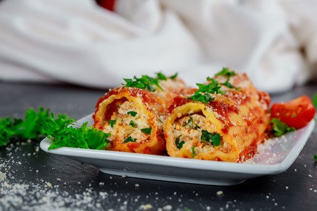 Cannelloni with meat cheese and tomato sauce 免版税图像