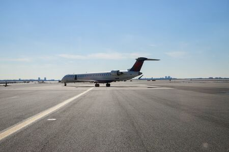FEB 14, 2019 JFK NEW YORK, USA: Al DELTA aircraft at the John F. Kennedy International Airport plane taking off runway It is the international air passenger gateway in the United States Редакционное