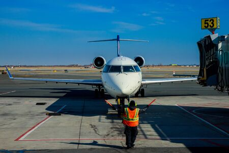 FEB 14, 2019 JFK NEW YORK, USA: Front view of landed airplane in a terminal of DELTA aircraft at the John F. Kennedy International Airport Editorial