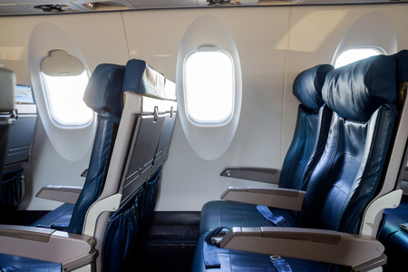 Interior passenger airliner cabin, of the aircraft during the flight of tourists flying into a airplane inside interior