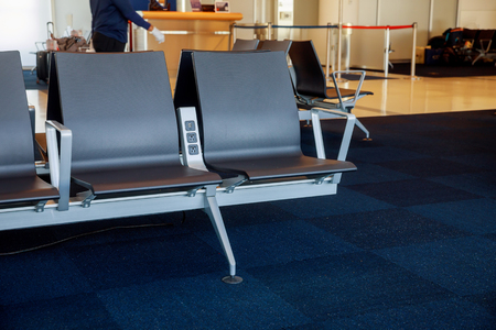 Empty seat in the airport in the departure hall at terminal waiting area