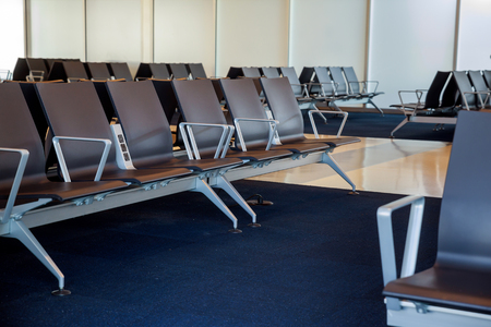 Empty departure lounge airport terminal waiting area with chairs Stock Photo