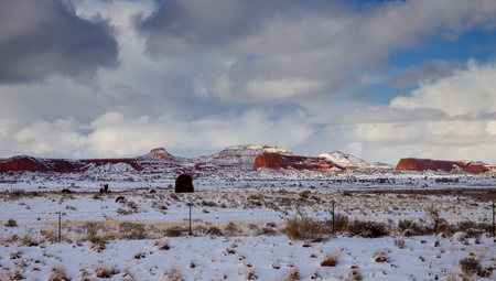 Clouds in a sky over a mountain rock in New Mexico winter landscape