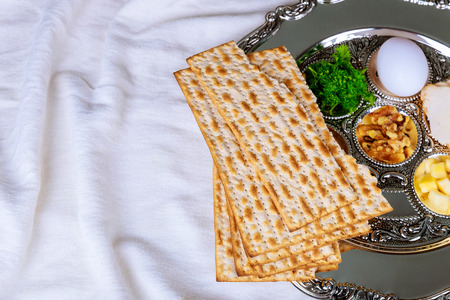 Passover matzoh jewish holiday bread over wooden table background.