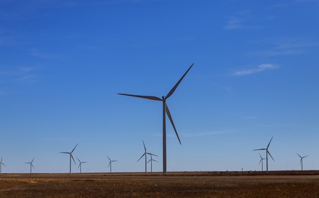 A windmill with modern wind turbines in the located in West Texas sunny day
