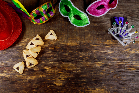 Hamantaschen cookies or hamans ears and mask for Purim celebration jewish carnival holiday selective focus Stock Photo