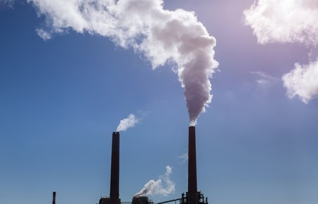 Cooling towers and chimneys of coal power plant big blue clouds Standard-Bild - 118927016