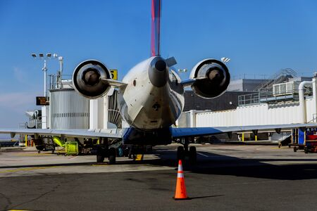 FEB 14, 2019 JFK NEW YORK, USA: DELTA airplane sits grounded at a gate at JFK International Airport during