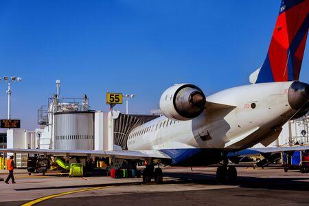 FEB 14, 2019 JFK NEW YORK, USA: Air DELTA airplane on parking position during pre flight preparation on JFK International Airport Редакционное