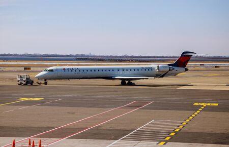 FEB 14, 2019 JFK NEW YORK, USA: Airplane at the terminal gate ready for takeoff John F. Kennedy International Airport Редакционное
