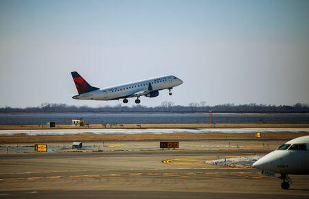 FEB 14, 2019 JFK NEW YORK, USA: Small Airplane with engines landing on runway
