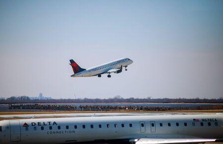FEB 14, 2019 JFK NEW YORK, USA: DELTA Airlines jet takes off at John F. Kennedy International Airport Редакционное