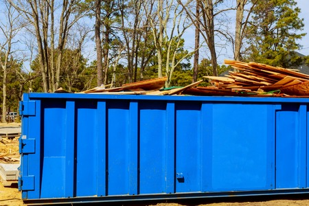 recycle waste and garbage bins near new construction of apartment houses building