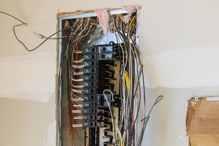 Electrical cabinet with circuit breaker on the mounting panel mounted holders the wires in cable