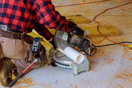 A plumber cut PVC pipe sawing pliers tool plumbing repair maintenance concept
