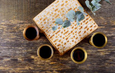 Red kosher four glasses wine with a of matzah a Passover Haggadah
