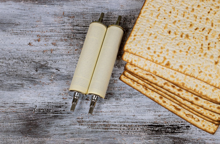 Jewish matza on torah scroll detail passover symbol unleavened bread