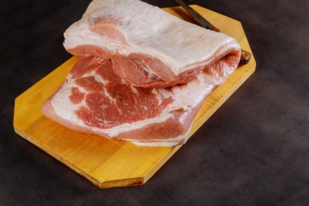 Top view raw pork chop on a wooden cutting board with free text space. Stock Photo