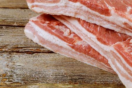 Fresh raw meat pork fresh chop bacon rustic wood background