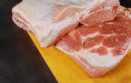 Raw pork on wooden cutting board ready for cooking Stock Photo