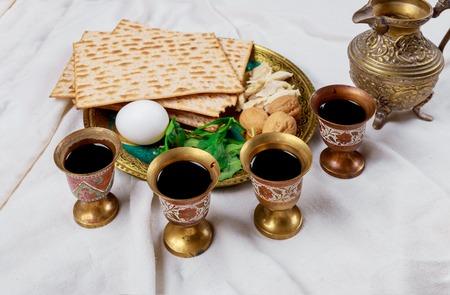 Red kosher wine four glasses of matzah or matza Passover Haggadah