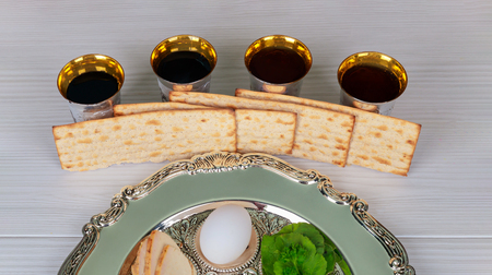 Passover red kosher four glasses wine with a of matzah a haggadah