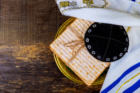 Jewish holiday passover matzot with seder on plateover wooden table background close up Stockfoto