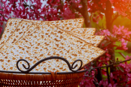 Jewish holiday passover matzot with seder on plateover wooden table background close up Stock Photo