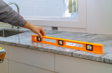 Installing with granite countertops renovation granite kitchen interior cabinet Stock Photo